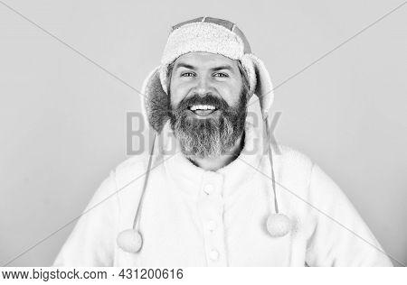 Pleasant Thoughts. Male Winter Style. Modern Winter Earflap Beanie Hat. Funky Happy Bearded Man. Mat