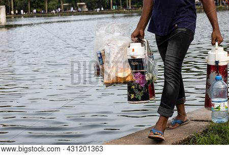 Dhaka, Bangladesh - 20 August 2021: A Street Vendor Selling Tea And Biscuits Inside Of Suhrawardy Ud