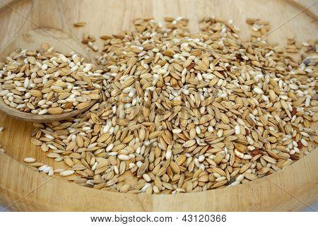 Raw rice on wood tray