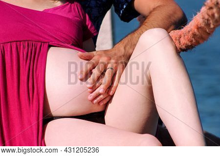 Hands Of Future Parents Is Embracing And Hugging On Pregnant Belly. Pretty Pregnant Woman Hug With H