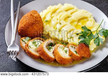 Chicken Kiev, Crumbed And Fried Chicken Breast Stuffed With Melting Garlic Butter Served With Mashed
