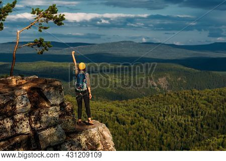 The Traveler Is Happy To Climb The Mountain. A Girl Meets The Sunset In The Mountains. Mountain Spor