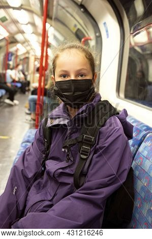 Young Teenage Girl With Face Covering Mask On The Subway. Mask Against Covid. Teenager With Face Mas