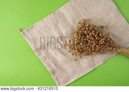 Bouquet Of Beautiful Natural Dry Flax Linen Boxes Closeup On A Linen Organic Material, Linen Bag. Im