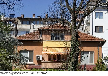 Sofia, Bulgaria -  April 25, 2021: Blooming Spring Trees Against The Background Of A Residential Are