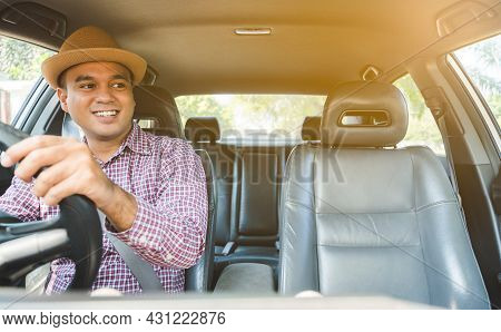 Front View Of Young Asian Man Driving Car.
