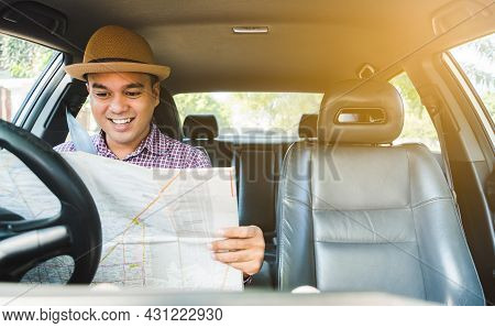 Man Look At The Map Inside Car