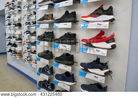 Ukraine, Dnipropetrovsk. 05.06.2021big Collection Of Different Sport Shoes. Image Of Shelves Of The