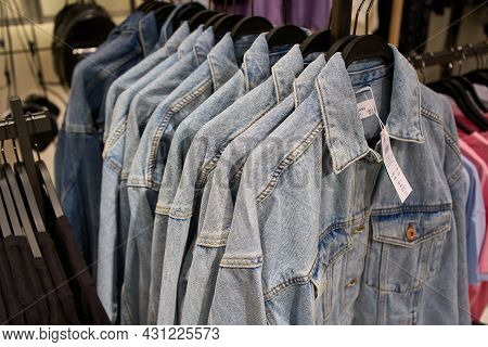 Ukraine, Dnipropetrovsk. 05.06.2021close Up Of Colorful T-shirts On Hangers. T Shirts Shop. High Qu
