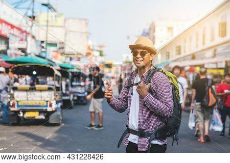 Young Asian Traveling Man Walking In Khaosan Road Walking Street At Bangkok