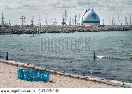 Hel, Poland - 08.01.2021: So Cold Egg Building And Ocean Pier Behind It In Port Of Hel In Late After