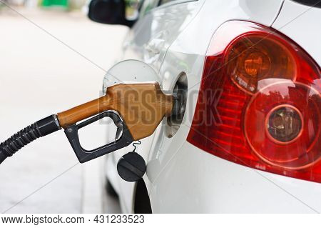 To Fill The Machine With Fuel. Car Fill With Gasoline At A Gas Station