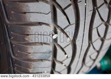 Metallic Nail In Car Tyre Close Up, Car Tyre Repair