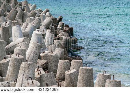 Detail Shot Of Concrete Tetrapod Dolosse Breakwater With Steel Eyes Protecting The Port Of Hel, Pola