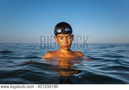 Boy Bathes In The Sea