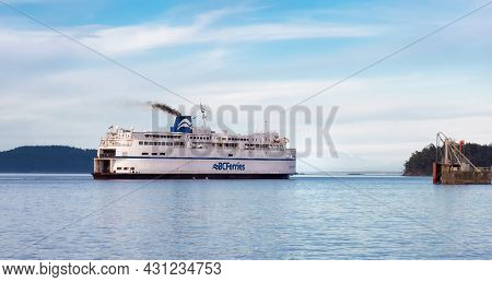 Victoria, Vancouver Island, British Columbia, Canada - August 9, 2021: Bc Ferries Boat Arriving To T