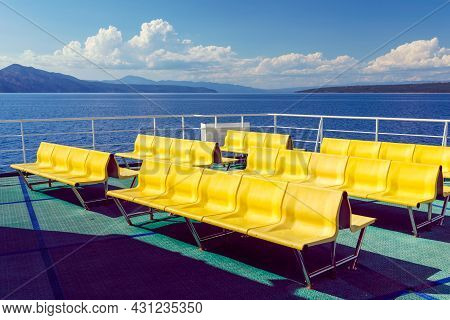Empty Yellow Chairs - Benches - On The Upper Deck Of The Adriatic Ferry In Croatia