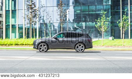 Genesis Gv80 Suv Is Driving In The Cityscape. It Is A Mid-size Luxury Crossover Suv Manufactured By