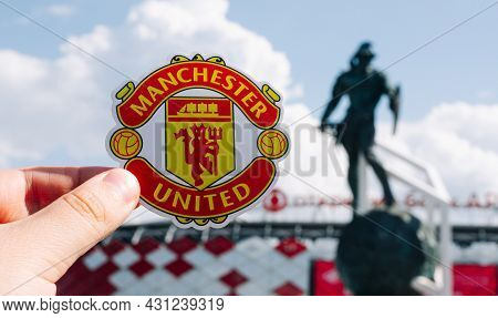June 14, 2021 Manchester, Uk. Manchester United F.c. Football Club Emblem Against The Backdrop Of A