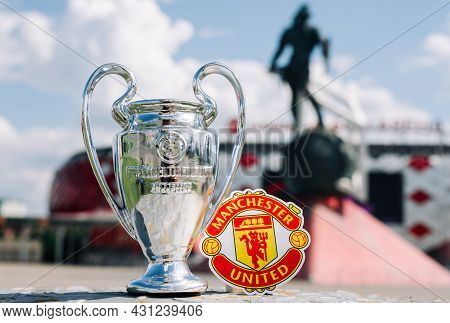 June 14, 2021 Manchester, Uk. Manchester United F.c. Football Club Emblem And The Uefa Champions Lea