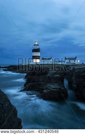 Hook Head, Wexford, Ireland, June, 2019. The Hook Lighthouse At Wexford Ireland In A Cloudy Night.