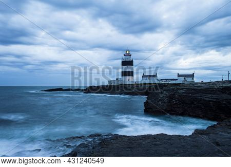 Hook Head, Wexford, Ireland, June, 2019. Hook Lighthouse At Wexford Ireland In A Cloudy Night.