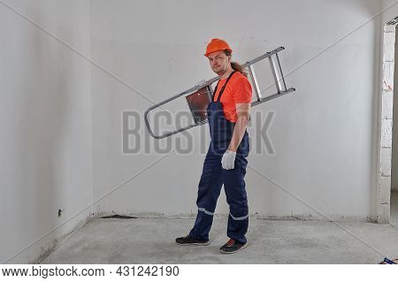 Full- Length Cheerful Engineer Holding A Stepladder