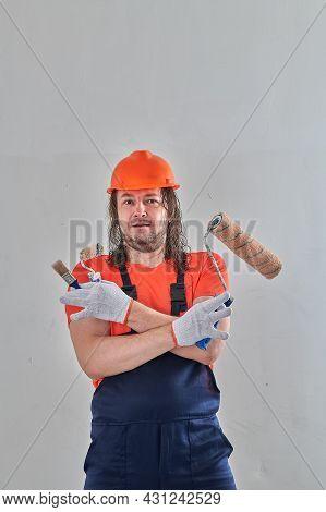 Serious Repairman With Tools To Repair The Apartment