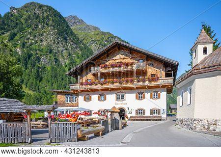 Matrei In Osttirol, Austria - August 21, 2021: Matreier Tauernhaus - Typical Alpine Hotel And Restau