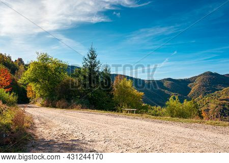 Country Gravel Road In Apuseni Mountains, Cluj Country, Romania. Sunny Autumn Scenery In Morning Lig