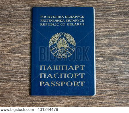 Passport Of A Citizen Of The Republic Of Belarus On A Wooden Background. Close-up.
