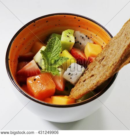 Mixed Fresh Fruit Bowl Includes Kiwi, Berries, Papaya, Dragonfruit, Melon Etc.