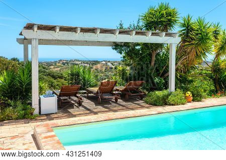 Gazebo In Garden Near The Pool With A View Of The Pine Forest, A Place For Tourists To Relax. Sun Be