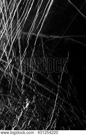 Wrinkled plastic wrap texture on a black background wallpaper