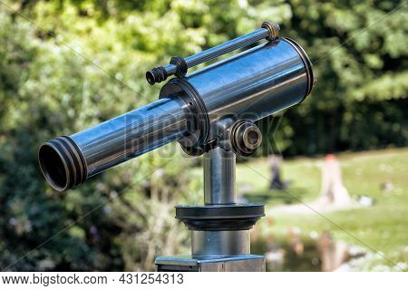 A Telescope For Observing Touristic Sightseeings And Animals At Zoo.
