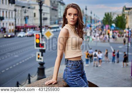 Sexy Woman In Jeans Is Standing Near Crowded Crosswalk.