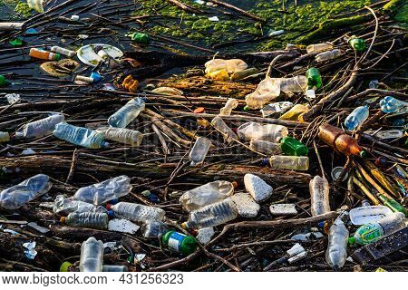 Dirty Polluted Waste Water With Garbages. Environment Pollution Concept. Urban Environment Issues In