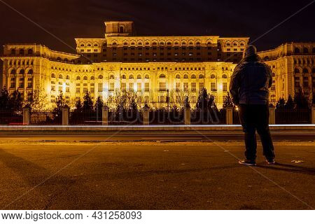 Man In Front Of Palace Of Parliament, Bucharest, Romania
