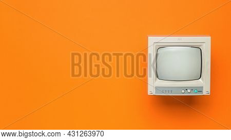 Vintage Tv On An Orange Background. Space For The Text. Retro Equipment. Flat Lay.