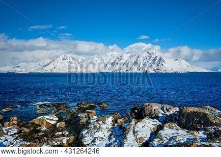 Lofoten islands and Norwegian sea in winter with snow covered mountains. Lofoten islands, Norway