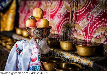 Offerings (Tibetan Water Offering Bowls) in Thiksey gompa (Tibetan Buddhist monastery). Ladakh, India