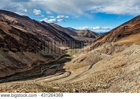 View of valley with road near Tanglang la Pass - mountain pass in Himalayas along the Leh-Manali highway. Ladakh, India