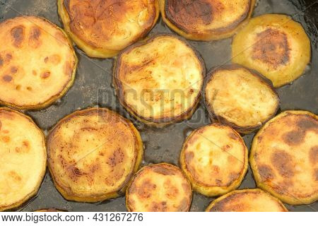 Slices Of Zucchini Is Frying On Frying Pan With Oil On Coals In The Grill On Nature, Closeup Top Vie