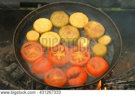 Slices Of Zucchini Is Frying On Frying Pan With Oil On Coals In The Grill On Nature, Closeup View. P