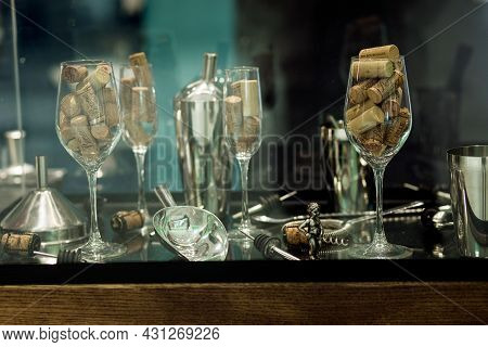 Minsk, Belarus, August 2021 - Collection Of Wine Corks In A Glass Goblet. Glass For Red Wine Filled