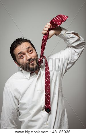 Young Bearded Man Pretending To Hang Himself With A Tie