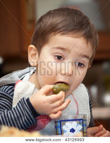 Little Boy Eats Pickles