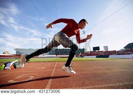 Starting blocks. Sprinter man starting on the sport arena.