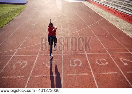 young man sprinter run on track stadium in athletics competition