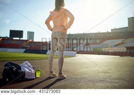 Sport. Runner on stadium. Woman runner during outdoor workout